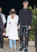 Megan Fox looks striking in a white trench coat during a date night with Machine Gun Kelly at Nobu in Malibu, California