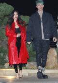 Megan Fox looks stunning a fur-lined red coat during a date night with Machine Gun Kelly at Nobu in Malibu, California