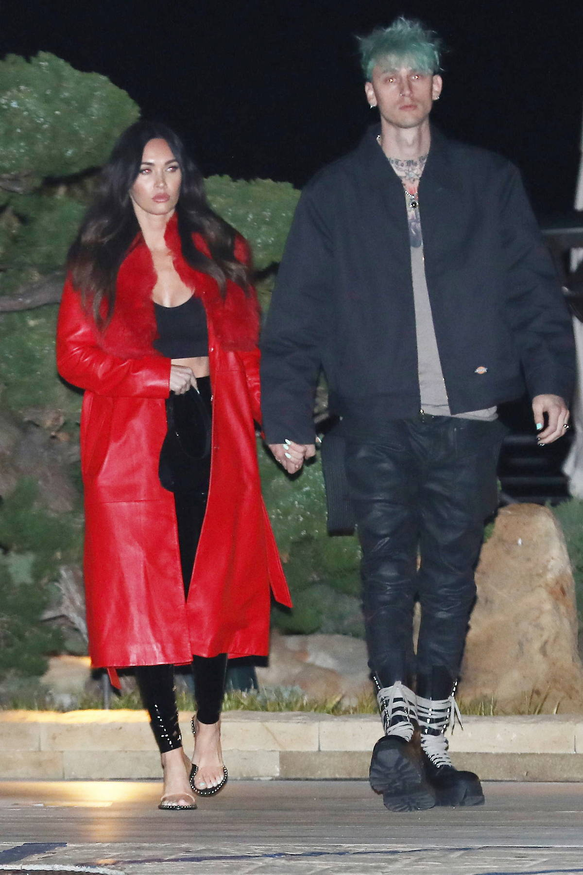 Megan Fox looks stunning a fur-lined red coat during a date night with Machine Gun Kelly at Nobu in Malibu, California