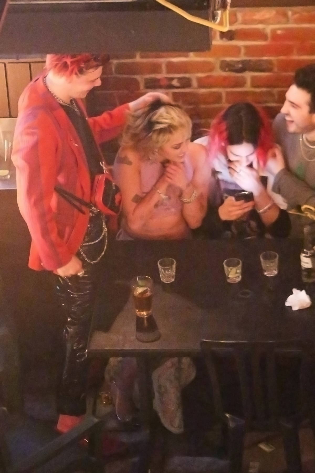 miley cyrus sparks dating rumors as she gets frisky with yungblud while out  with friends at rainbow room in los angeles-250321_1