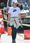 Minka Kelly looks great in a cropped tee and leggings as she enjoys a hike with her dog on Mulholland Drive in Los Angeles