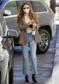 Miranda Kerr looks chic in a brown blazer with Louis Vuitton bag while visiting a dermatology office in Beverly Hills, California