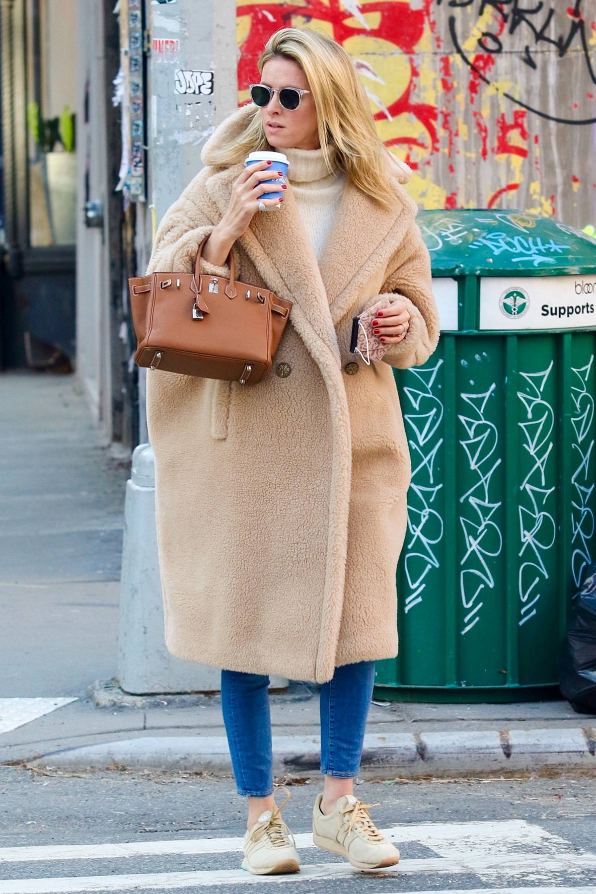 Nicky Hilton looks stylish in a brown teddy coat while making a coffee run in Downtown Manhattan, New York City