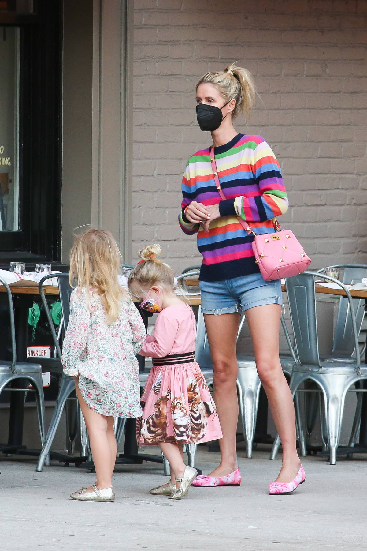 Nicky Hilton spotted in a colorful striped sweater while stepping out with her two daughters in New York City