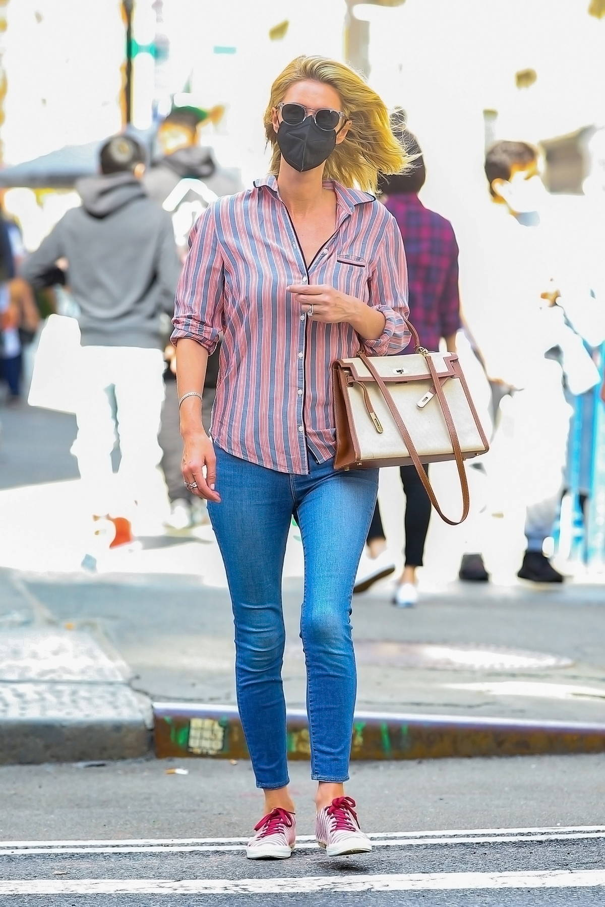 Nicky Hilton wears a striped shirt and matching sneakers with skinny jeans while out running errands in New York City