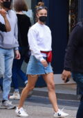 Nina Agdal rocks a sweatshirt with a short denim skirt, and sneakers while out with Jack Brinkley-Cook in New York City