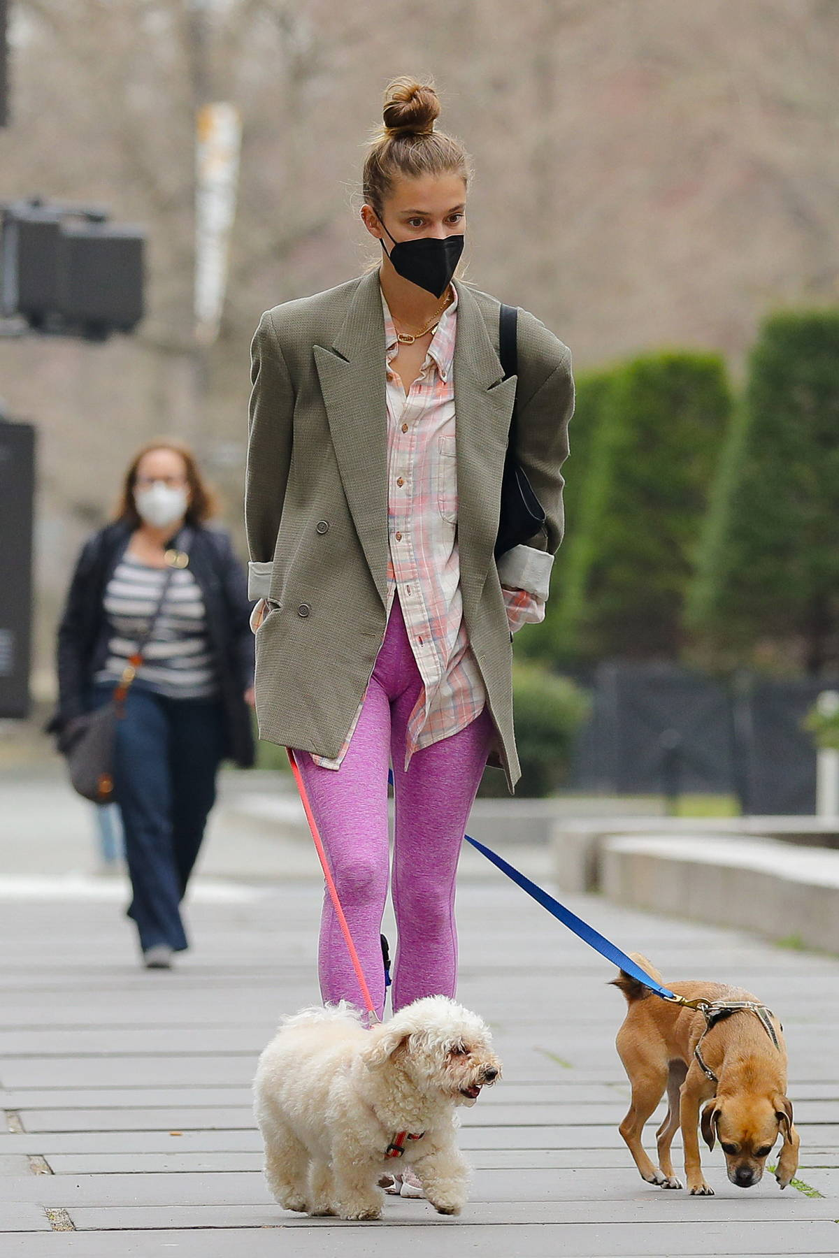 Nina Agdal wears pink leggings with a blazer while out for a stroll with her dogs in New York City