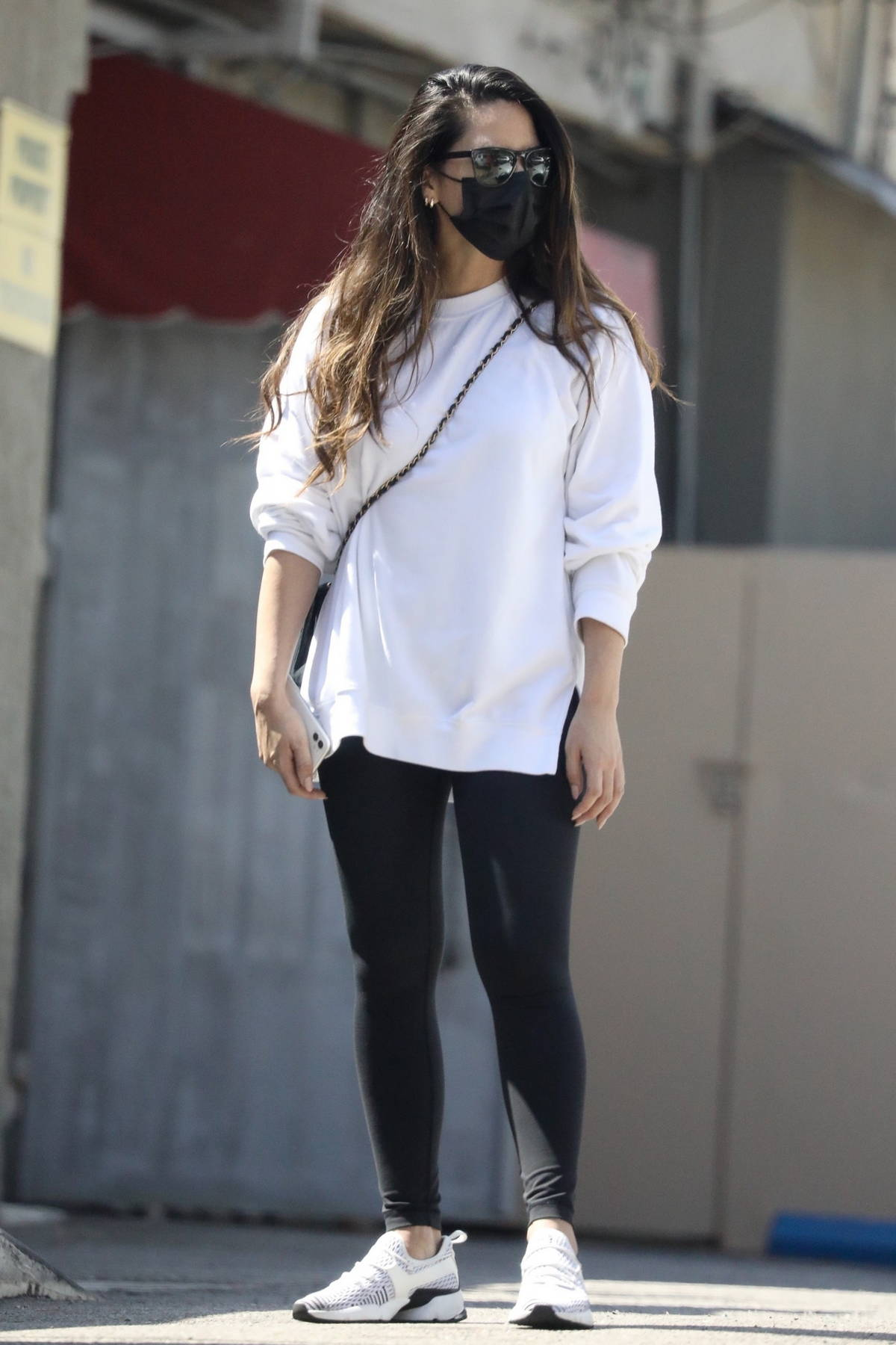 Olivia Munn seen leaving a workout session wearing a white sweatshirt and black leggings in West Hollywood, California