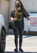 Olivia Munn sports black leggings with 'Nirvana' tee as she leaves her gym in West Hollywood, California