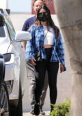 Olivia Munn spotted in a blue checkered shirt over a cropped tee and leggings while leaving a gym in Santa Monica, California