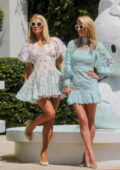 Paris Hilton and Nicky Hilton pose for photos in their floral print mini dresses outside the W Hotel in Miami Beach, Florida