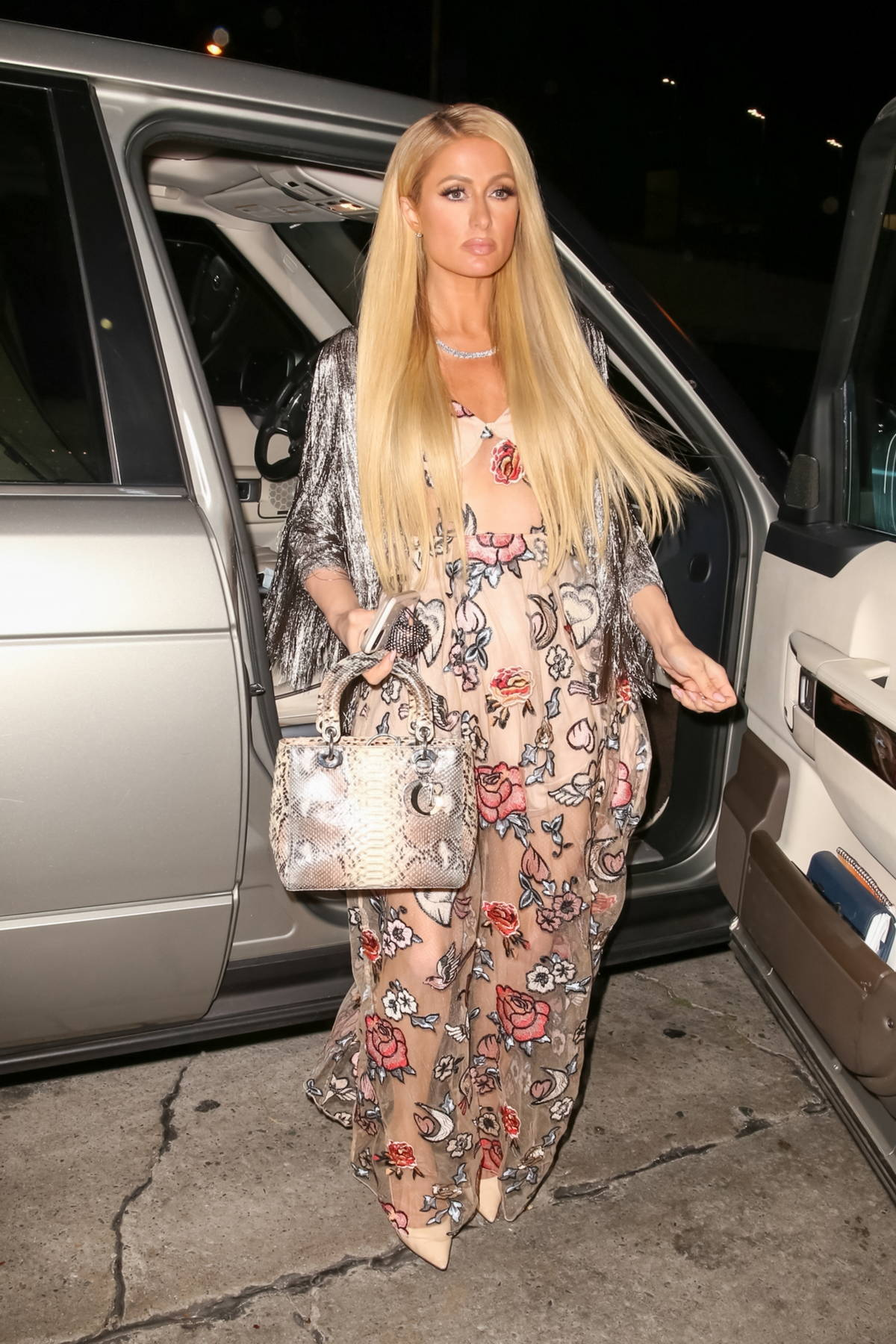 Paris Hilton looks stylish during a night out with fiancé Carter Reum in West Hollywood, California