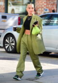 Pia Mia flashes her toned abs in a black crop top paired with a green suit while grabbing coffee in Westwood, California