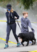 Reese Witherspoon shows off her toned legs in dark grey leggings while out on a family hike in Santa Monica, California