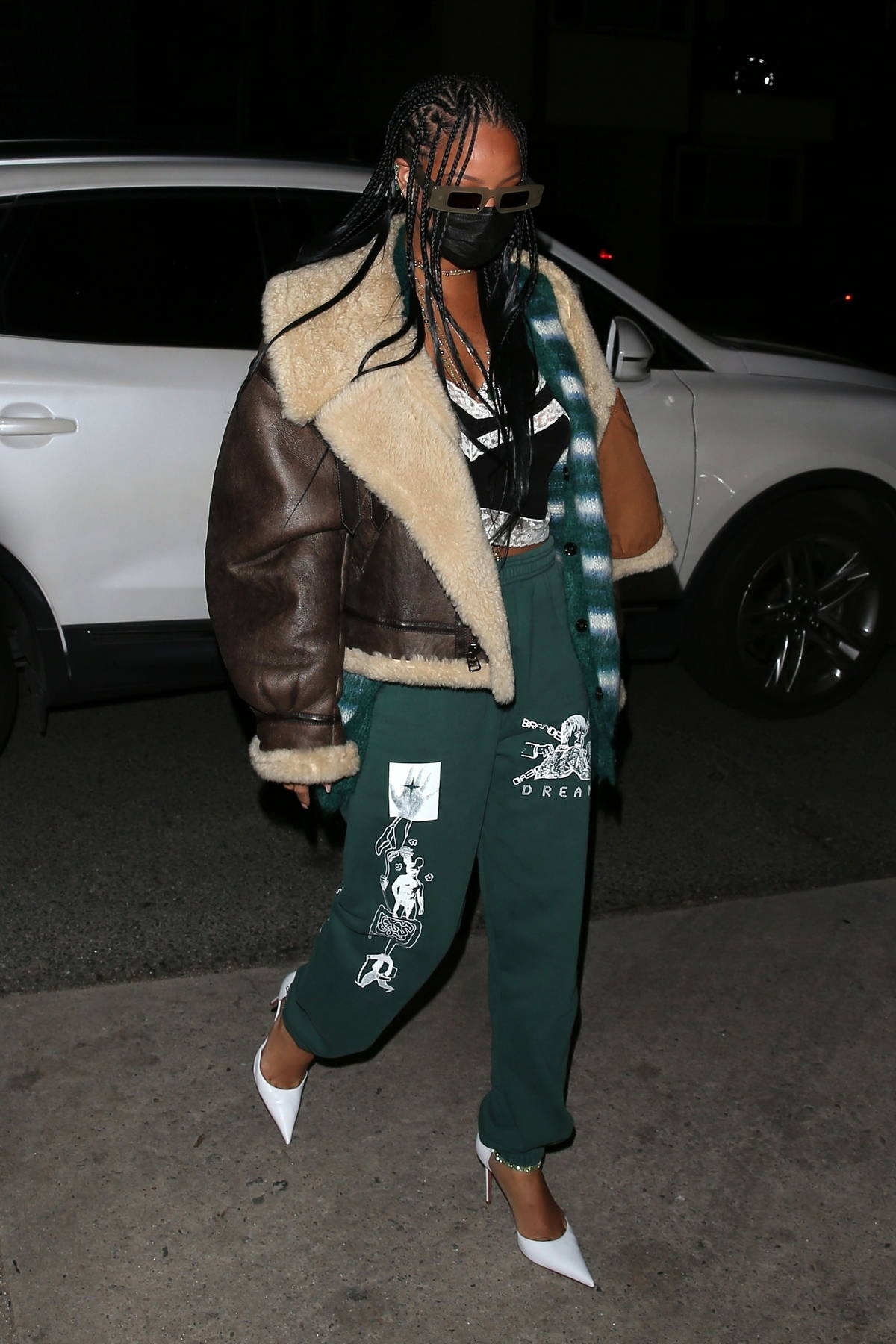 Rihanna keeps it fashionable in a green outfit as she arrives for a solo dinner at Giorgio Baldi in Santa Monica, California