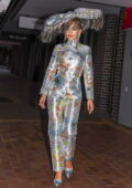 Rita Ora dazzles in a silver jumpsuit with a large tasseled hat as she heads out to celebrate Mardi Gras in Sydney, Australia