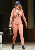 Rita Ora flaunts her curves in peach-colored leggings and jacket as she hits the gym in Sydney, Australia