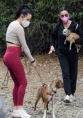 Rumer Willis wears a beige crop top and red leggings while out for a hike with her mom Demi Moore in Los Angeles