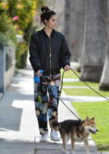 Sara Sampaio wears a bomber jacket with colorful sweatpants as she takes her dogs out for a walk in Los Angeles