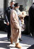 Selena Gomez cradles her puppy as she arrives on set for 'Only Murders in the Building' in New York City
