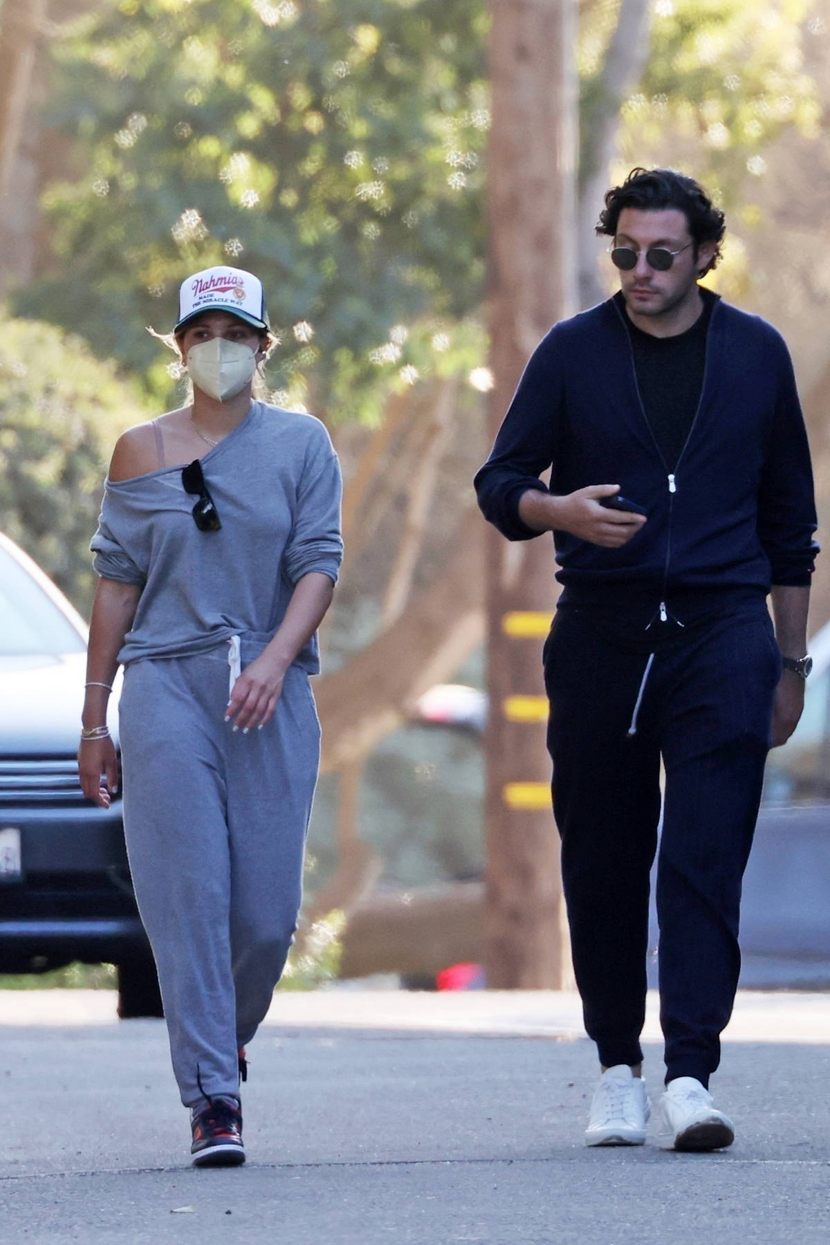 Sofia Richie dresses down in grey sweatsuit while out for an evening stroll with a mystery man in Los Angeles