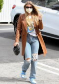 Sofia Richie rocks a tan leather jacket and ripped jeans as she steps out in Hollywood, California