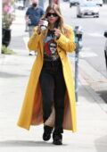 Sofia Richie sports a t-shirt featuring her dad Lionel Richie with a yellow trench coat while out in Los Angeles