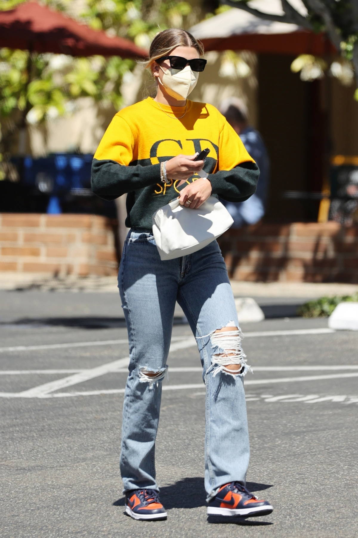 Sofia Richie sports a two-toned sweatshirt and ripped jeans while running errands around Santa Barbara, California