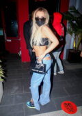 Tana Mongeau displays her quirky style in ripped jeans for a dinner outing at BOA Steakhouse in West Hollywood, California