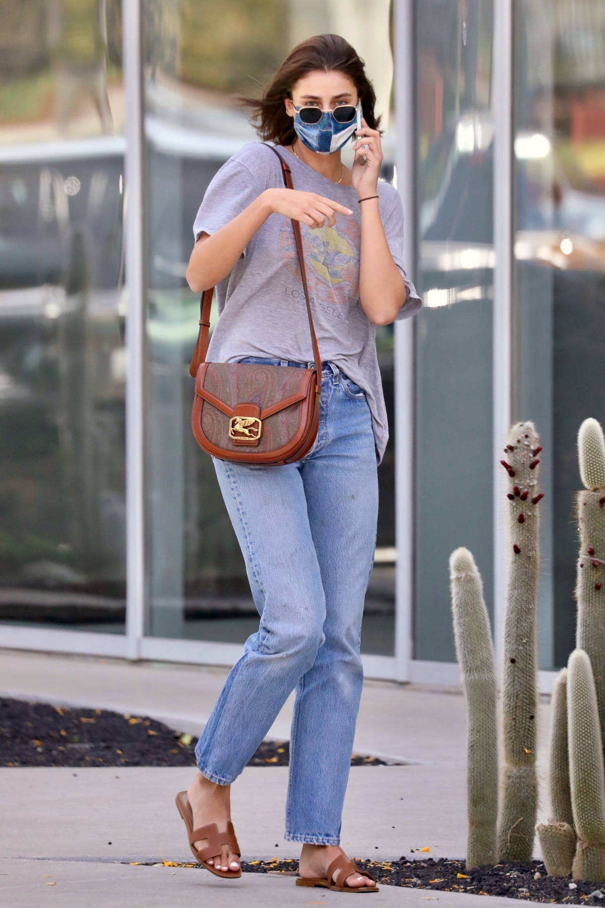 Taylor Hill goes casual with a tee and jeans while out running errands in Los Angeles