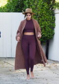 Taylor Hill shows off her amazing figure in matching crop top and leggings as she steps out barefoot in Los Angeles