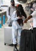 Vanessa Hudgens keeps it cozy in a tie-dye sweatsuit as she arrives at LAX airport in Los Angeles