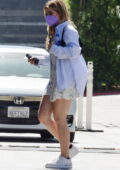 Addison Rae wears a cute minidress while driving through in her pink Tesla in Beverly Hills, California