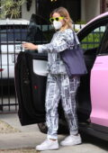 Addison Rae wears newspaper print sweats while visiting friends in Hollywood, California