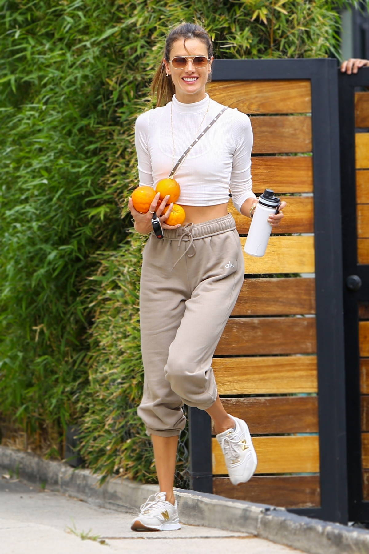 Alessandra Ambrosio flashes her ripped midriff in a white crop top while attending a Pilates class in Beverly Hills, California