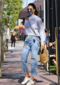Alessandra Ambrosio keeps it casual in distressed jeans and a sweatshirt while grabbing food to-go in Brentwood, California