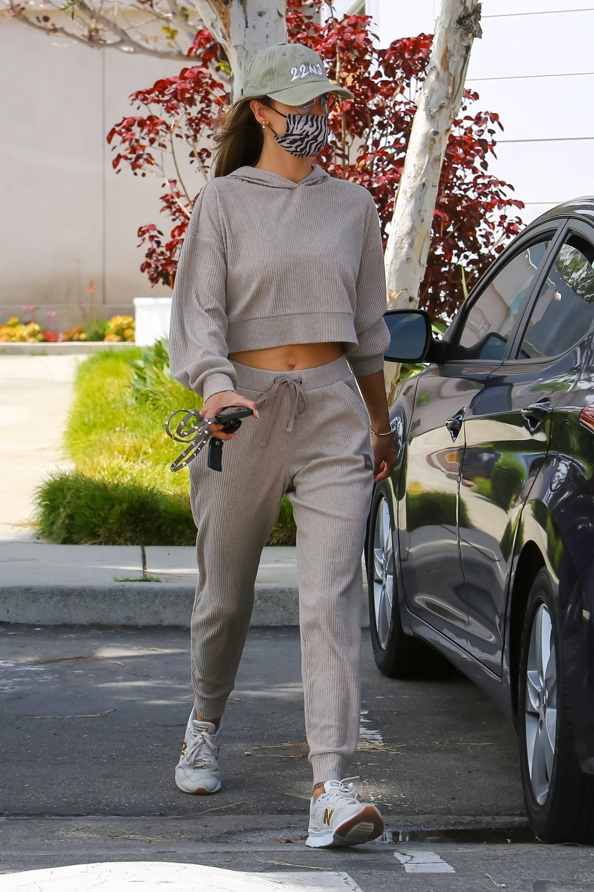 Alessandra Ambrosio looks casually chic in a grey sweatsuit during a lunch outing with friends in Malibu, California