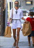 Alessandra Ambrosio shows off her summer style in all-white shorts and top while out for shopping in Pacific Palisades, California