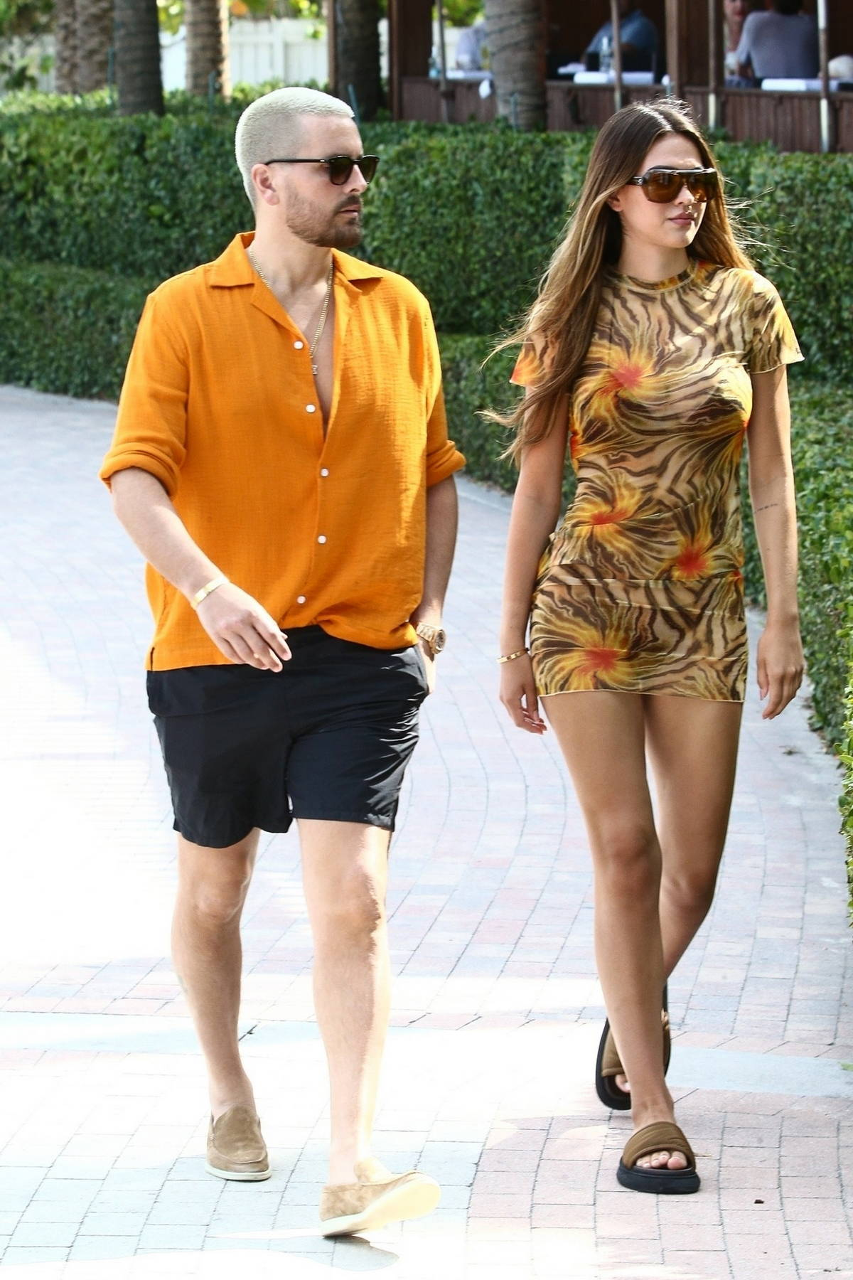 Amelia Hamlin puts on a leggy display in a floral print mini dress while she and Scott Disick hit the beach in Miami, Florida