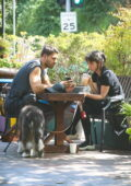 Ana de Armas enjoys an iced-coffee with a mystery man while out to walk her pup in Los Angeles