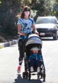 Anne Hathaway wears a tie-dye tee and leggings for a walk with her youngest son Jack and a friend in Hollywood, California