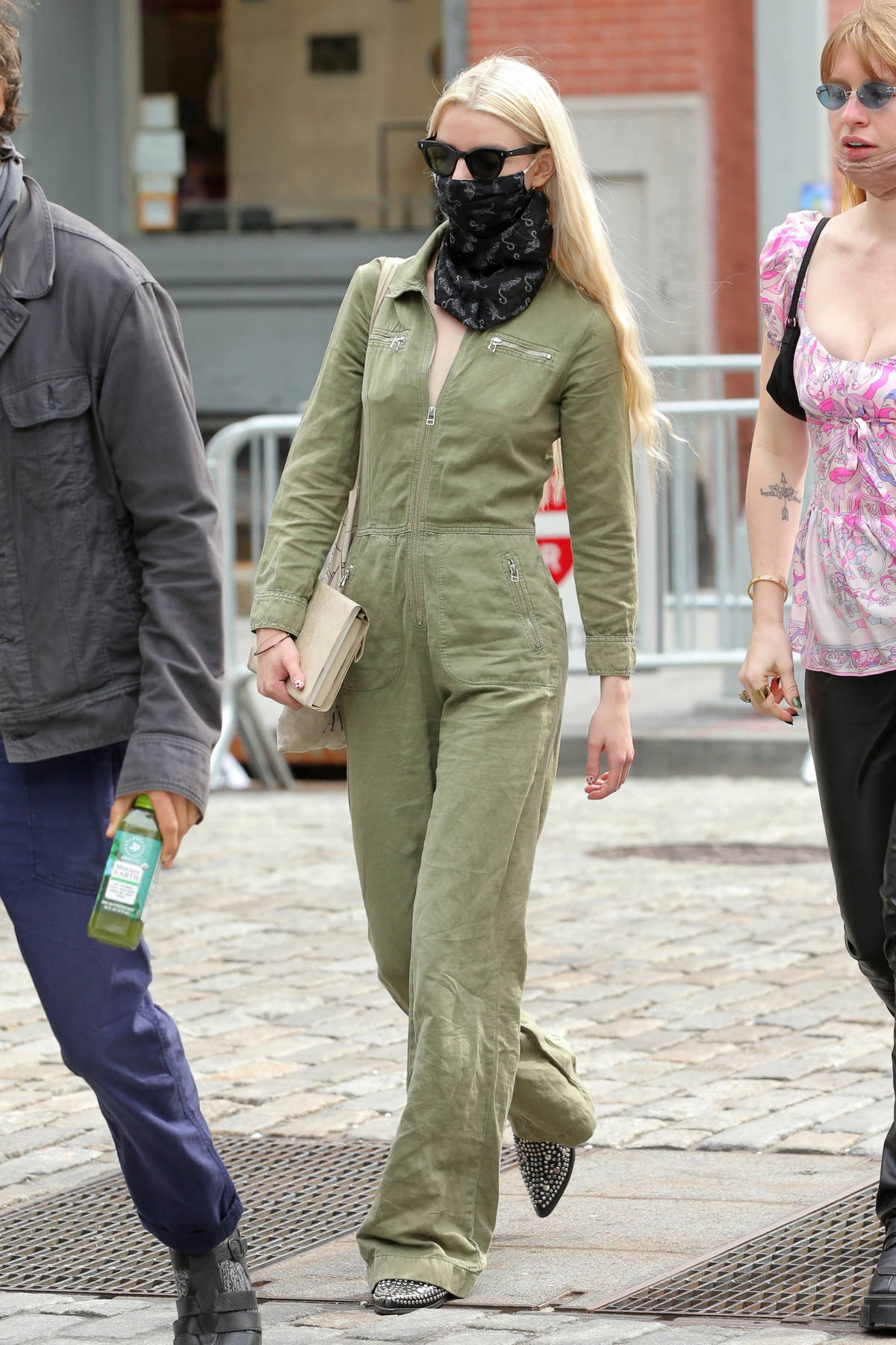 Anya Taylor-Joy steps out in green denim jumpsuit while making a coffee run with a friend in New York City