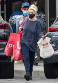 Ariel Winter wears an oversized sweatshirt while out shopping with a friend at Urban Outfitters and CVS in Studio City, California