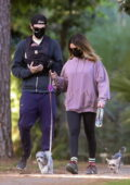 Ashley Tisdale and Christopher French take a walk with their newborn daughter and two dogs in Los Feliz, California