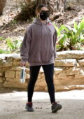 Ashley Tisdale wears a hoodie and leggings for a solo hike in Los Feliz, California