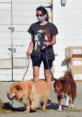 Aubrey Plaza steps out wearing a vintage 'Snoop Dog' tee and legging shorts while walking her dogs in Los Feliz, California