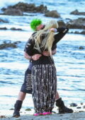 Avril Lavigne and Mod Sun enjoy a romantic lovers stroll on the beach in Malibu, California