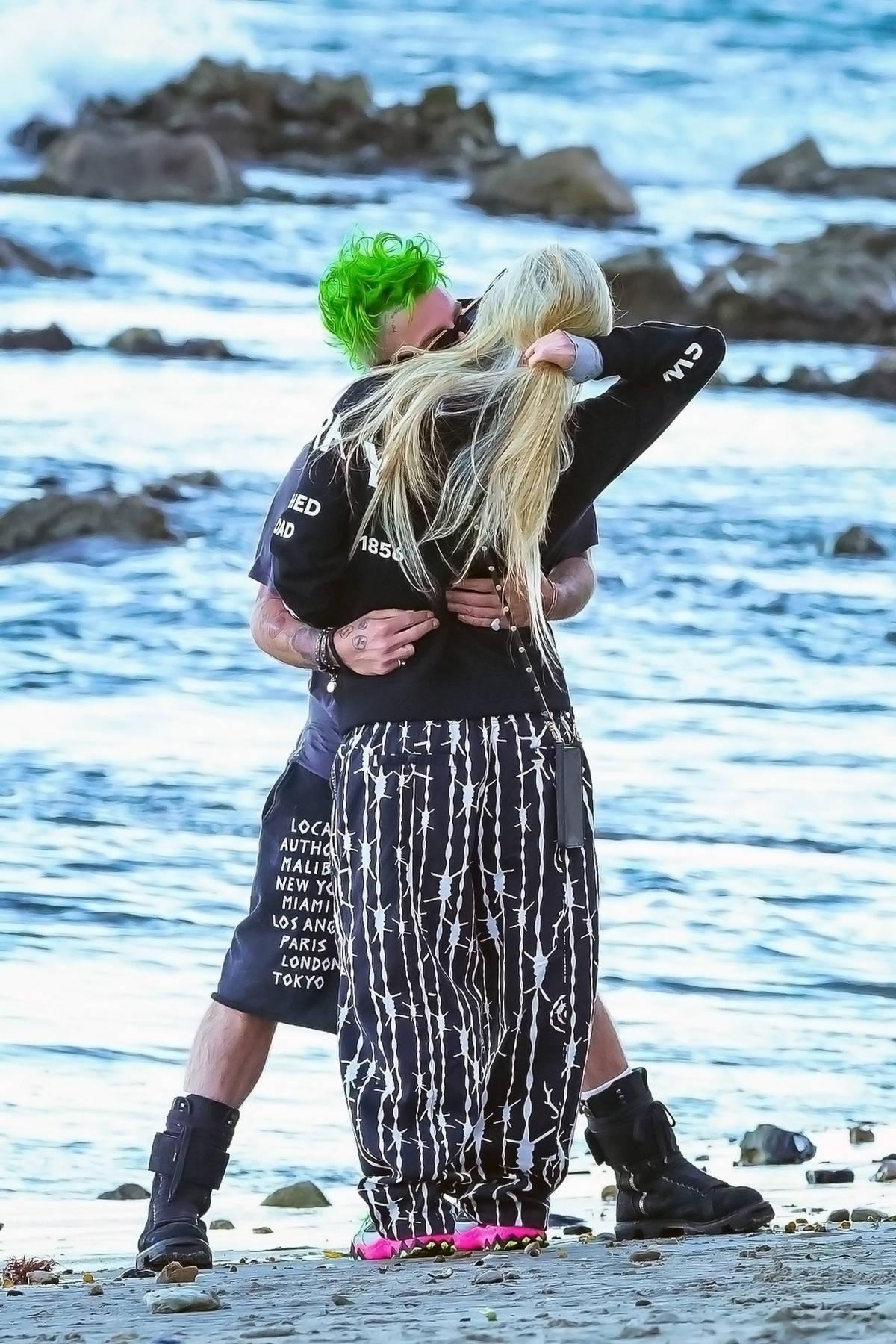 Avril Lavigne and Mod Sun enjoy a romantic lovers stroll on the beach in Malibu, California