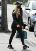 Avril Lavigne dons all-black hoodie, leggings and sneakers while out shopping with girlfriends in Malibu, California