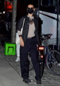 Bella Hadid flashes a peace sign as she leaves after a photoshoot in New York City
